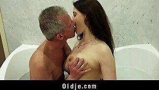 Busty nasty latina girl gives old man wet pleasing in the bathtub